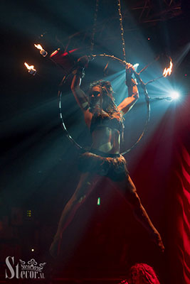 fire aerial hoop performance by Marlene Kiepke at the Los Muertos Halloween edition of the International Burlesque Circus