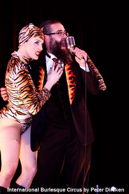 the host Mr Weird Beard and the amazing stagetiger Mama Tigra at the Burlesque Circus show